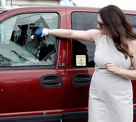 .jpg photo of director of kidsandcars.org shows how to break glass and save child from hot vehicle